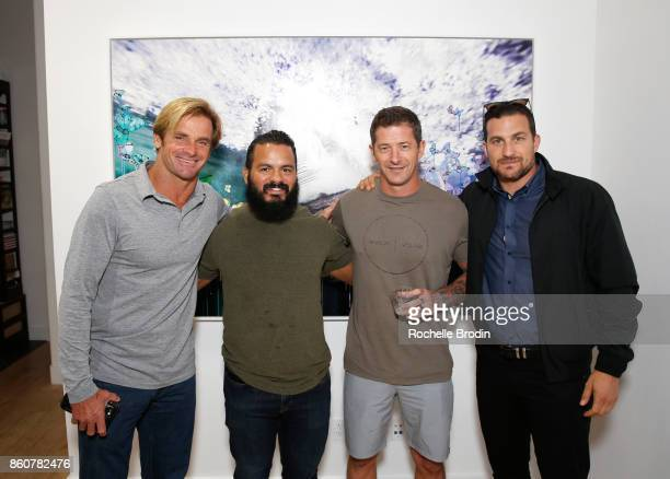 Professional surfer Laird Hamilton Brian Diaz Andrew Huberman and Brian Mackenzie attend the Michael Muller and Sage Vaughn exhibit presented by...