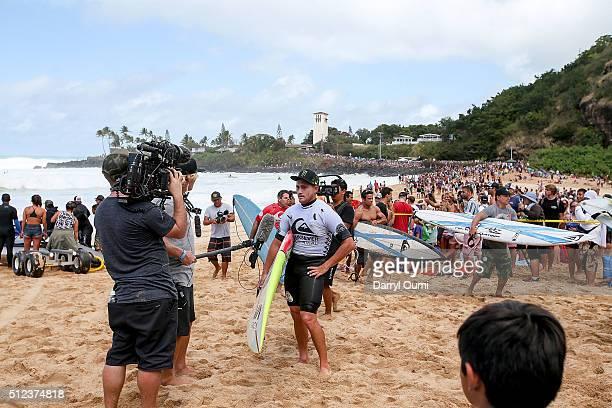 Professional surfer Makua Rothman is interviewed after his first round heat at Waimea Bay on February 25 2016 in Waimea Hawaii