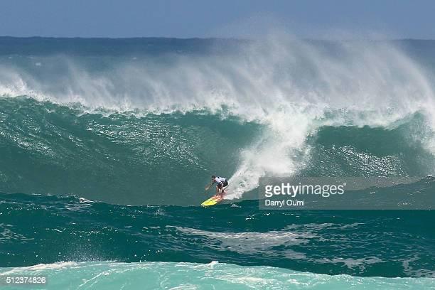 Professional surfer Makua Rothman navigates his way down the face of a wave at Waimea Bay on February 25 2016 in Waimea Hawaii