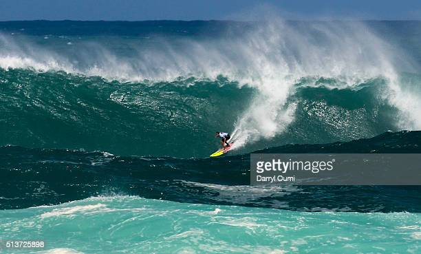 Professional surfer Makua Rothmanrides a wave at The Quiksilver in Memory of Eddie Aikau at Waimea Bay on February 25 2016 in Waimea Hawaii