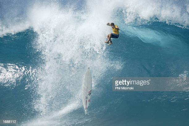 Professional surfer Rodrigo Dornelles of Brazile wipes out during the filming of WB network's reality TV show North Shore December 14 2002 in Haleiwa...