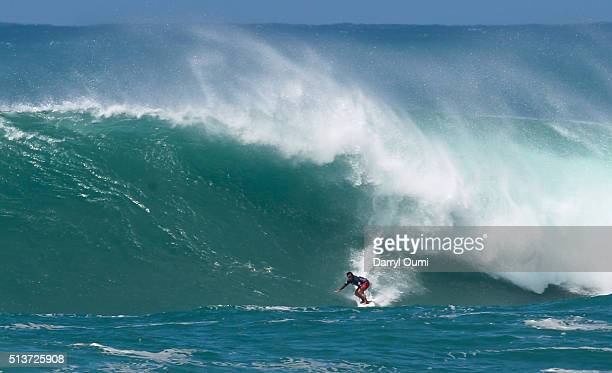 Professional surfer Ross ClarkeJones rides a wave in the second round of The Quiksilver in Memory of Eddie Aikau at Waimea Bay on February 25 2016 in...