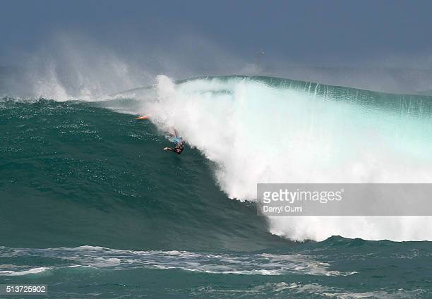 A professional surfer wipes out on a wave during the first round of The Quiksilver in Memory of Eddie Aikau at Waimea Bay on February 25 2016 in...