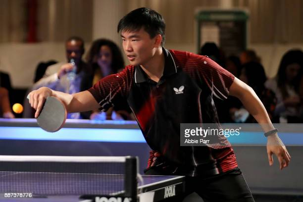 Professional Table Tennis Player Adam Hugh competes in the pro table tennis tournament during the TopSpin charity fundraiser at the Metropolitan...