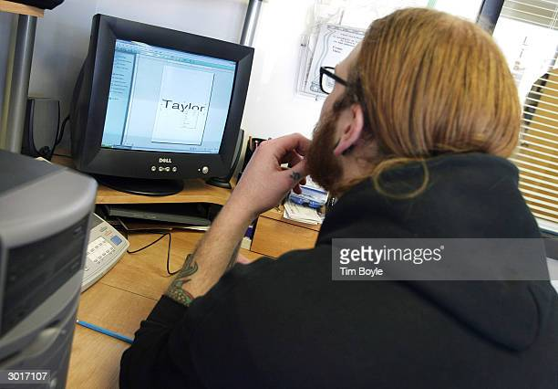 Professional tattoo artist Dave Tieman touches up fonts on a computer for a tattoo February 26 2004 at Liberty Tattoo in Libertyville Illinois...