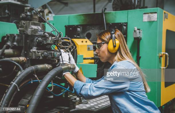 professional technical worker woman working with production line machine - manufacturing equipment stock pictures, royalty-free photos & images