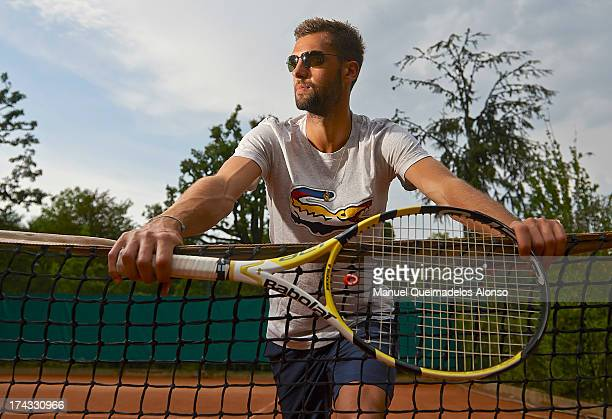 Professional tennis player Benoit Paire poses during a Maui Jim shoot at Lagardere Racing Club on July 23, 2013 in Paris, France.