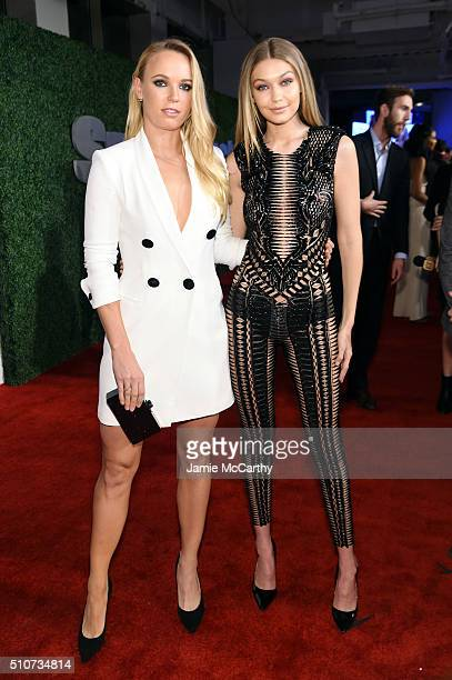 Professional tennis player Caroline Wozniacki and model Gigi Hadid attend the Sports Illustrated Swimsuit 2016 NYC VIP press event on February 16...
