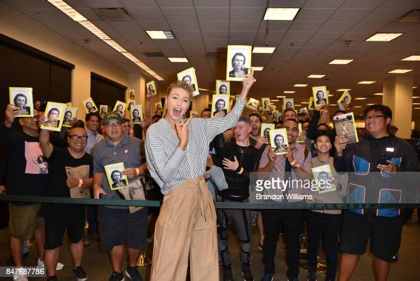 Professional tennis player Maria Sharapova poses with fans during the signing for her book 'Unstoppable My Life So Far' at Barnes Noble at The Grove...