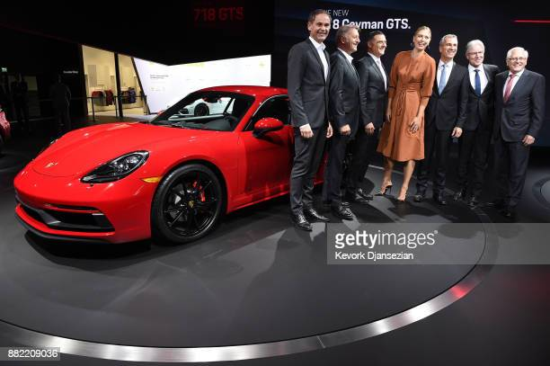 Professional tennis player Maria Sharapova poses with Porsche executive board members and other executives standing next to the Porsche 718 Cayman...
