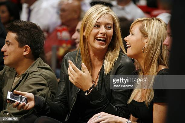 Professional tennis player Maria Sharapova watches the Boston Celtics play against the Miami Heat during the game on November 30 2007 at American...