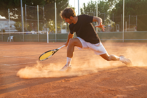 Professional tennis player on court 869105878