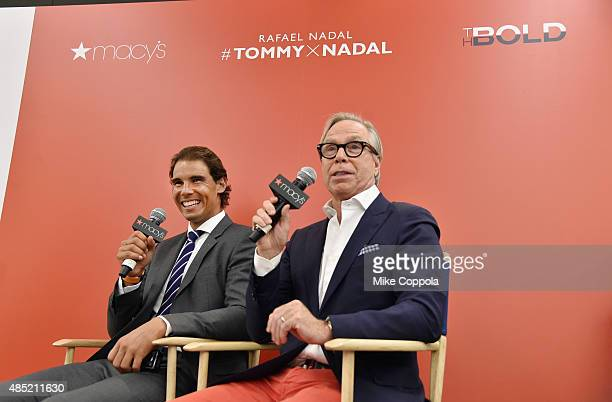 Professional tennis player Rafael Nadal and Tommy Hilfiger speak to each other as Rafael Nadal makes a personal appearance at Macy's Herald Square at...