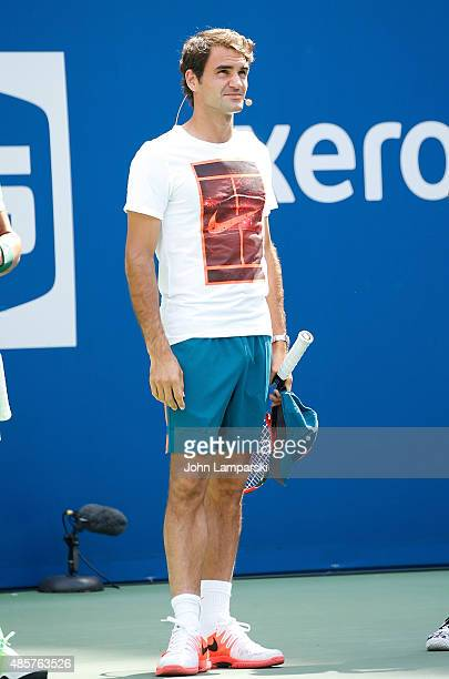 Professional tennis player Roger Federer participates during the 20th Annual Arthur Ashe Kids' Day at USTA Billie Jean King National Tennis Center on...