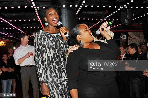 Professional tennis player Venus Williams and Principal and CoFounder of Wishbone Consulting Group Isha Price sing onstage at Driving Force Giving...