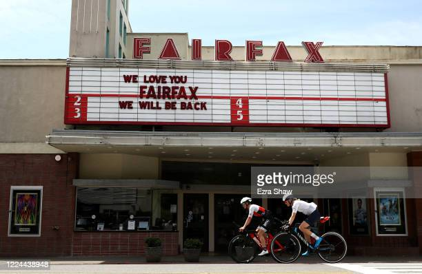 Professional triathlete Sarah Piampiano and her training partner Chelsea Sodaro ride past a closed movie theater during a training ride on May 8,...