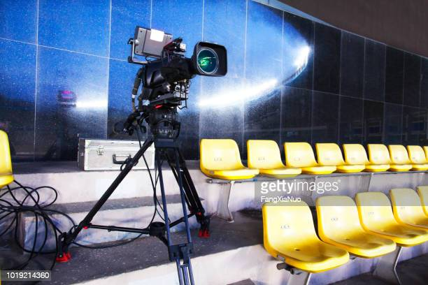professional tv camera filming event in a stadium - television camera stock pictures, royalty-free photos & images