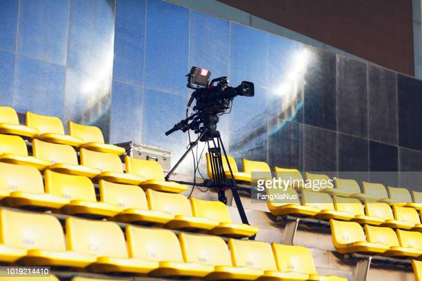 professional tv camera filming event in a stadium - cinema audio society stock photos and pictures