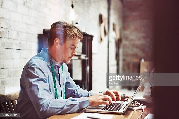Professional using laptop in bridal shop