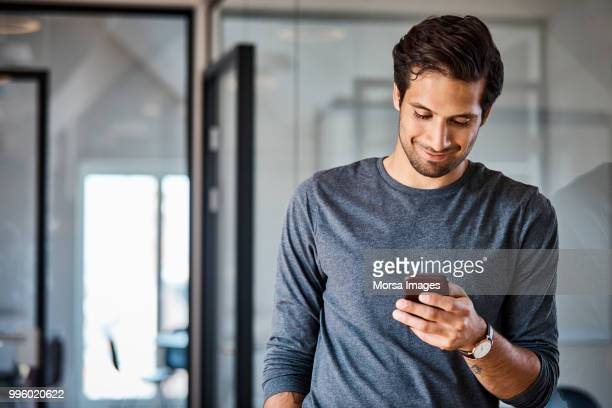 Professional using mobile phone at office