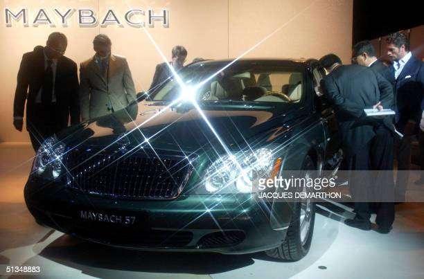 Professional visitors view the new Maybach 57 restyled by DaimlerChrysler displayed at the Paris Auto show at the Porte de Versailles exhibition...
