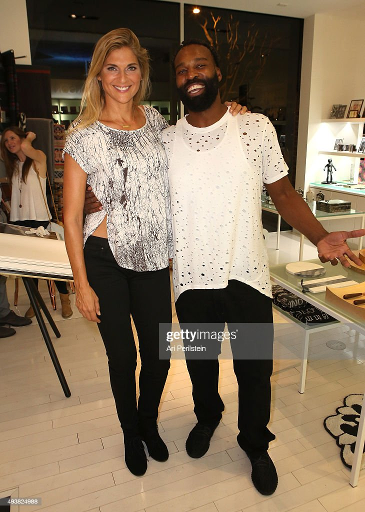 Professional volleyball player Gabrielle Reece (L) and professional basketball player Baron Davis attend the launch of Laird Apparel by Laird Hamilton at Ron Robinson on October 22, 2015 in Santa Monica, California.