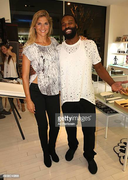 Professional volleyball player Gabrielle Reece and professional basketball player Baron Davis attend the launch of Laird Apparel by Laird Hamilton at...