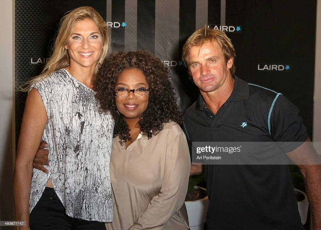 Professional volleyball player Gabrielle Reece, Oprah Winfrey, and professional surfer Laird Hamilton attend the launch of Laird Apparel by Laird Hamilton at Ron Robinson on October 22, 2015 in Santa Monica, California.