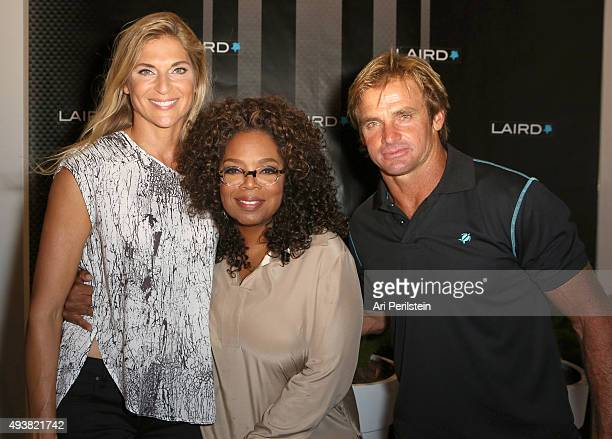 Professional volleyball player Gabrielle Reece, Oprah Winfrey, and professional surfer Laird Hamilton attend the launch of Laird Apparel by Laird...