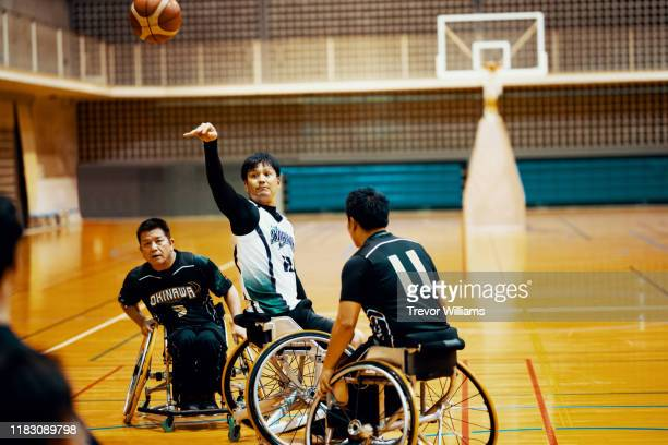 professional wheelchair basketball team playing a game and practicing - team photo ストックフォトと画像