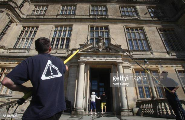 Professional window cleaners Nick Walker and Daniel Barr clean one of the windows at the front of Longleat House ahead of the summer season on June 2...