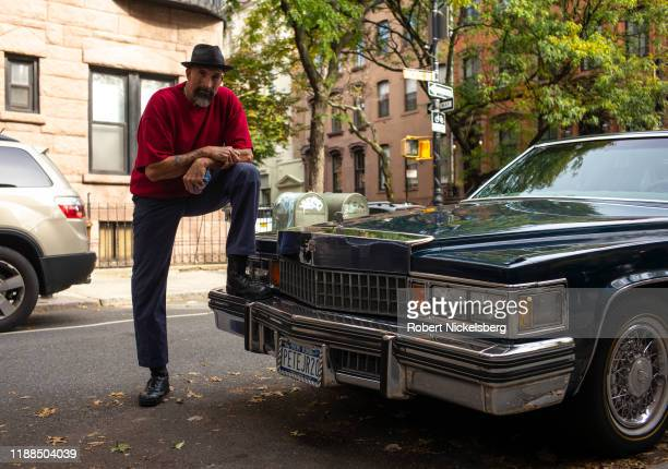 Professional window washer Pete Lucenti stands with his 1978 Cadillac Coupe de Ville on a street in the Brooklyn borough in New York City, October...