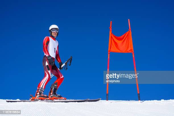 professional winter sports, skier during race track inspection at clear blue sky - pole stock pictures, royalty-free photos & images