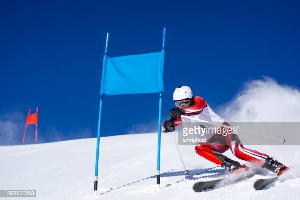 professional winter sports, super g skier on ski slope - ski racing stock pictures, royalty-free photos & images