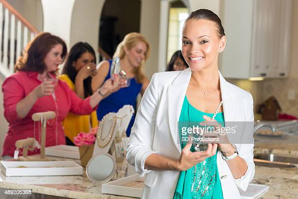 professional woman attending direct sales home jewelry party - household equipment stock pictures, royalty-free photos & images