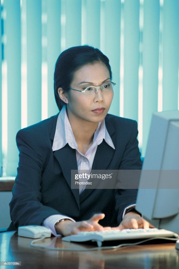 Professional woman on computer : Stock Photo