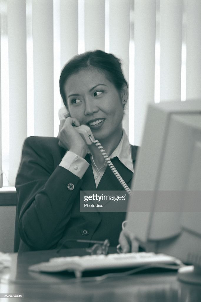 Professional woman on phone : Stock Photo