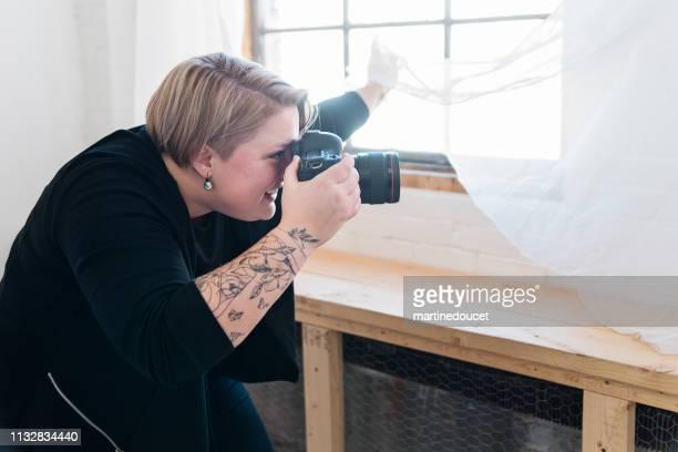 Professional woman photographer working in studio.