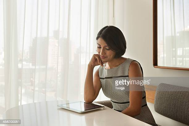professional woman reading digital tablet - women wearing see through clothing stock pictures, royalty-free photos & images