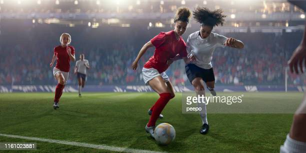 professional women soccer player dribbling ball past rival during match - sports league stock pictures, royalty-free photos & images