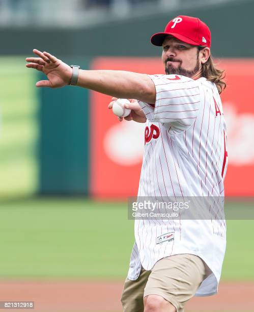 Professional wrestler A.J. Styles throws out the first pitch at the Milwaukee Brewers Vs Philadelphia Phillies Game at Citizens Bank Park on July 23,...