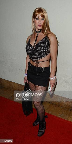 Professional wrestler Chyna attends a launch party for the new CD released by musical artist WonG at the Sunset Room October 9 2001 in Hollywood CA