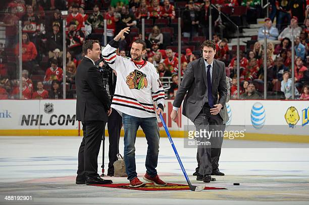 Professional wrestler CM Punk addresses the crowd before taking his shot in between periods of Game Two of the Second Round of the 2014 Stanley Cup...
