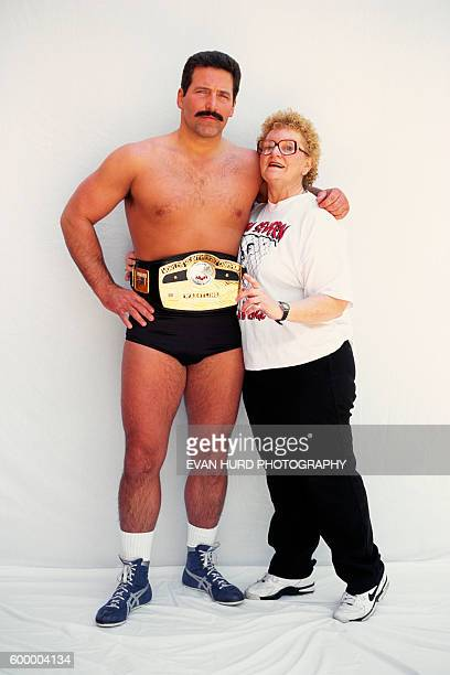 Professional wrestler Dan 'The Beast' Severn with a fan during the 1995 Ultimate Fighting Championship