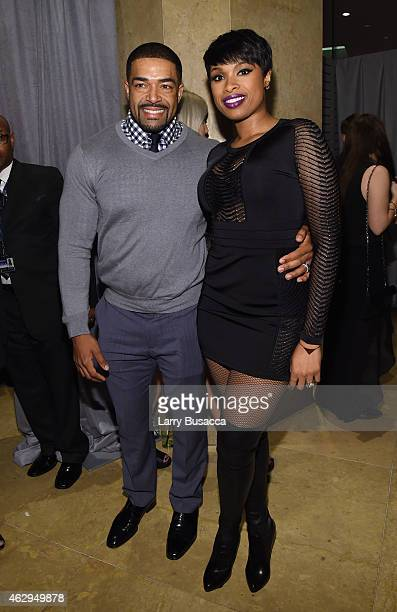Professional wrestler David Otunga and recording artist Jennifer Hudson attend the PreGRAMMY Gala and Salute To Industry Icons honoring Martin...