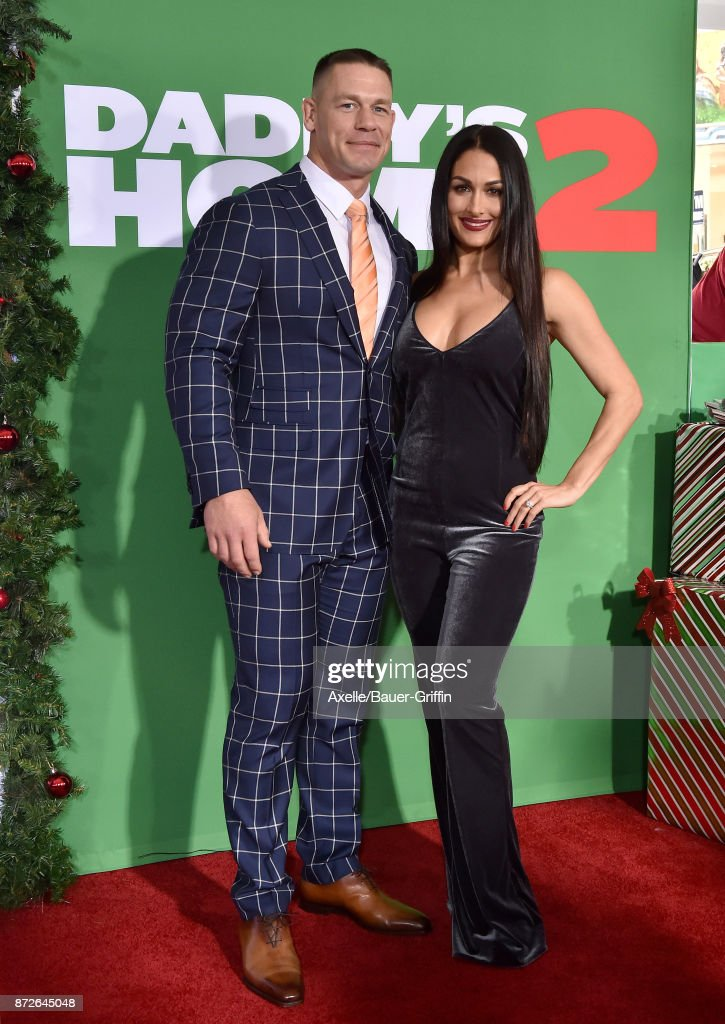 Professional wrestler John Cena and Nikki Bella arrive at the premiere of Paramount Pictures' 'Daddy's Home 2' at Regency Village Theatre on November 5, 2017 in Westwood, California.