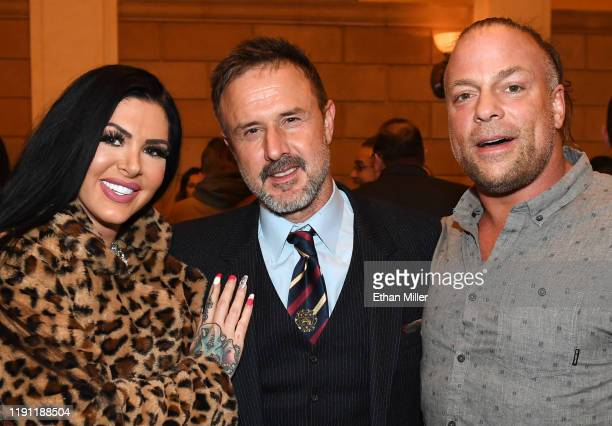 Professional wrestler Katie Forbes actor/producer David Arquette and professional wrestler Rob Van Dam pose after a QA for the screening of Saban...