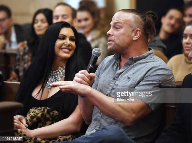 Professional wrestler Katie Forbes looks on as professional wrestler Rob Van Dam asks a question during a QA for the screening of Saban Films' Mob...