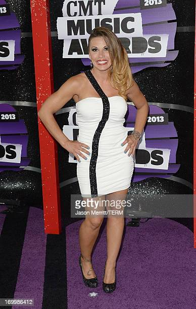 Professional wrestler Mickie James attends the 2013 CMT Music awards at the Bridgestone Arena on June 5 2013 in Nashville Tennessee