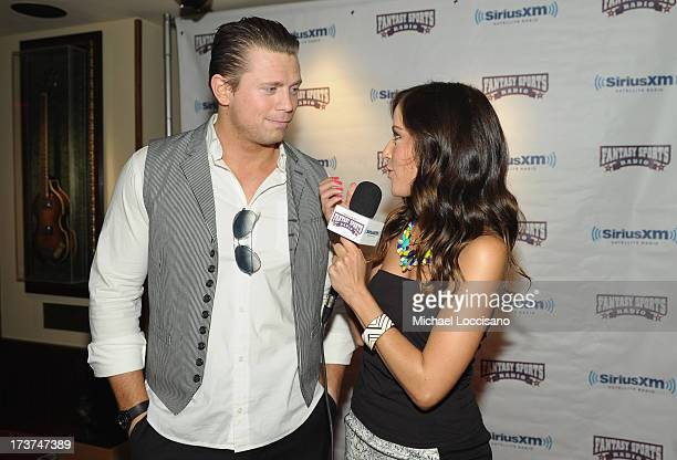 Professional wrestler Mike 'The Miz' Mizanin and SiriusXM radio host Kay Adams attend the SiriusXM Celebrity Fantasy Football Draft at Hard Rock Cafe...